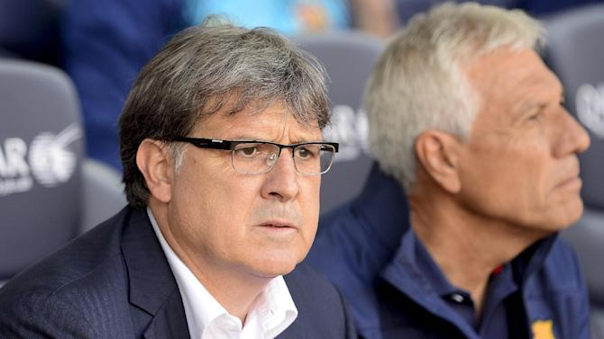 """Barcelona's Argentinian coach Gerardo """"Tata"""" Martino looks on during the Spanish league football match FC Barcelona vs Club Atletico de Madrid at the Camp Nou stadium in Barcelona on May 17, 2014"""