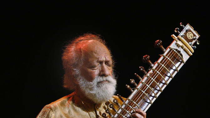 FILE - In this Feb. 7, 2012 file photo, Indian musician Ravi Shankar performs during a concert in Bangalore, India. Shankar, the sitar virtuoso who became a hippie musical icon of the 1960s after hobnobbing with the Beatles and who introduced traditional Indian ragas to Western audiences over an eight-decade career, has died. He was 92.  (AP Photo/Aijaz Rahi, File)