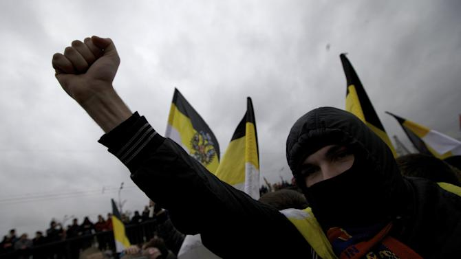 Ultra nationalist demonstrators and activists shout anti-government slogans as they march to mark National Unity Day, in Moscow, on Sunday, Nov. 4, 2012. The march took place on Unity Day, a national holiday established in 2005 to replace commemorations of Bolshevik Revolution. (AP Photo/Ivan Sekretarev)