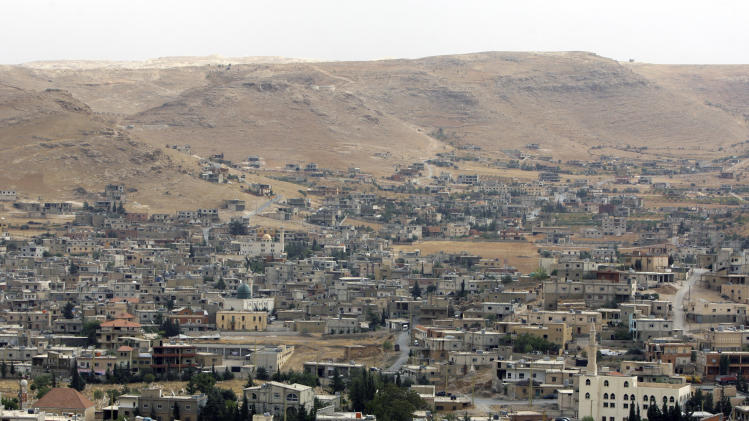 In this Tuesday, Oct. 2, 2012 photo, a general view of Arsal, a Sunni Muslim town eastern Lebanon near the Syrian border, has become a safe haven for war-weary Syrian rebels and hundreds of refugee families. Many in Arsal support the rebels, but the town's stand is risking heightened tensions with its Shiite Muslim neighbors in an area controlled by Hezbollah, a militia that backs the Syrian regime. Deepening sectarian rifts are one of the ways in which Syria's 18-month-old conflict is destabilizing an already volatile region. (AP Photo/Bilal Hussein)