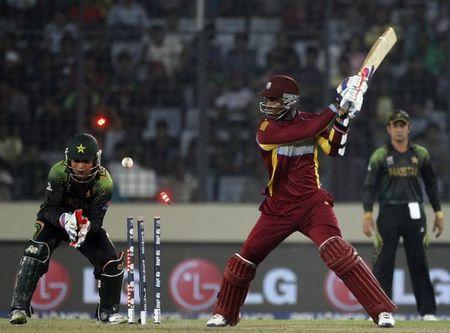 West Indies' Marlon Samuels is bowled out as Pakistan's wicketkeeper Kamran Akmal watches during their ICC Twenty20 World Cup match at the Sher-E-Bangla National Cricket Stadium in Dhaka
