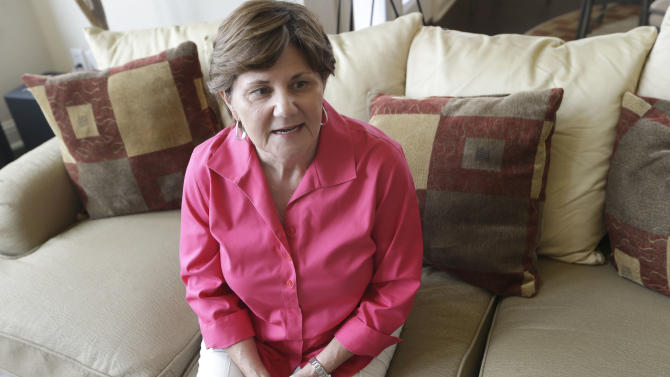 In this Aug. 1, 2013, photo, Donna Heller talks about her recent stomach illness in Burleson, Texas. After multiple visits to the doctor for debilitating nausea and diarrhea lasting a month, Heller was diagnosed with cyclospora by the CDC last week and began taking the antibiotic treatment just this week. A mysterious outbreak of the parasitic illness usually found abroad is growing, with more than 400 confirmed cases in 16 states. (AP Photo/LM Otero)