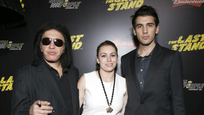 "Gene Simmons, Sophie Simmons and Nick Simmons attend the LA premiere of ""The Last Stand"" at Grauman's Chinese Theatre on Monday, Jan. 14, 2013, in Los Angeles. (Photo by Todd Williamson/Invision/AP)"