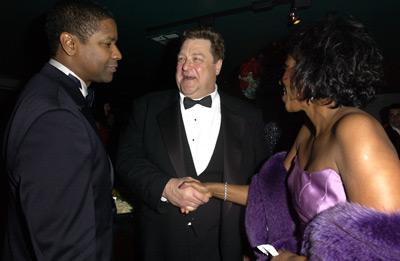 Denzel Washington and his wife with John Goodman Elton John AIDS Foundtation In-Style Party Hollywood, CA 3/24/2002