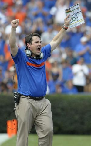 Florida head coach Will Muschamp celebrates after stopping Tennessee during the second quarter of an NCAA college football game in Gainesville, Fla., Saturday, Sept. 17, 2011. (AP Photo/Phelan M. Ebenhack)