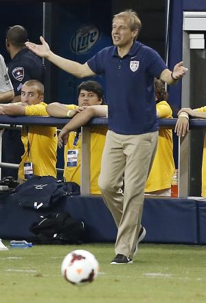 In this photo taken Wednesday, July 24, 203, United States manager Jurgen Klinsmann gestures on the sideline during the second half against the Hondurals in the semifinals of the CONCACAF Gold Cup soccer tournament at Cowboys Stadium in Arlington, Texas. The USA won 3-1 to advance to the final against Panama on Sunday, July 28, in Chicago. (AP Photo/Brandon Wade)