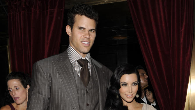 """FILE - This Aug. 31, 2011 file photo shows Kim Kardashian and Kris Humphries attending a party thrown in their honor at Capitale in New York. Kardashian's attorney Laura Wasser told a judge on Wednesday Nov. 28, 2012 that the reality starlet is """"handcuffed"""" to her estranged husband, Humphries, and unable to move on with her life because the NBA player continues to seek an annulment but is not ready for trial. (AP Photo/Evan Agostini, file)"""