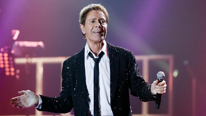 """FILE - In this Tuesday, May 13, 2014 file photo, British singer Cliff Richard performs on stage during the first show of his European tour 'Still Reelin' And A-Rockin' at the o2-Arena in Hamburg, Germany. British police say they are searching a house belonging to singer Cliff Richard in connection with sexual allegations dating back to the 1980s. South Yorkshire Police say eight officers are at the house in Berkshire, west of London on Thursday, Aug. 14, 2014. The force said the allegations """"involve a boy who was under the age of 16 at the time."""" (AP Photo/dpa, Markus Scholz, File)"""