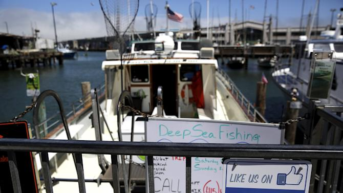 The Facebook logo is seen on a gate to a fishing vessel at Fisherman's Wharf in San Francico