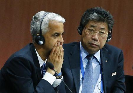 FIFA Executive Committee members Gulati of the U.S. and Zilong of China listen to  FIFA President Sepp Blatter at the 65th FIFA Congress in Zurich