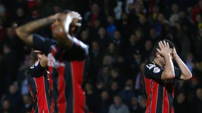 Gosling of Bournemouth and his teammates react after his shot was saved by Liverpool's Jones during their English League Cup quarter-final soccer match at Goldsands Stadium in Bournemouth