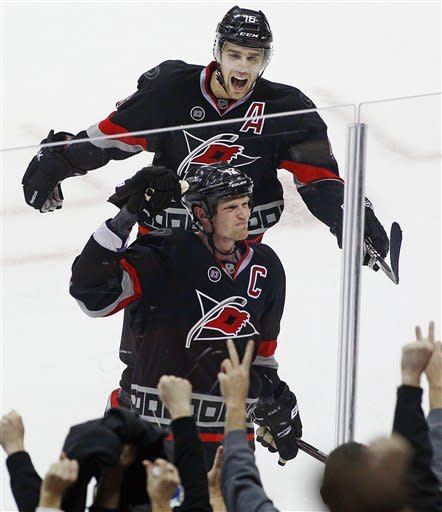Staal's OT goal caps Canes' comeback