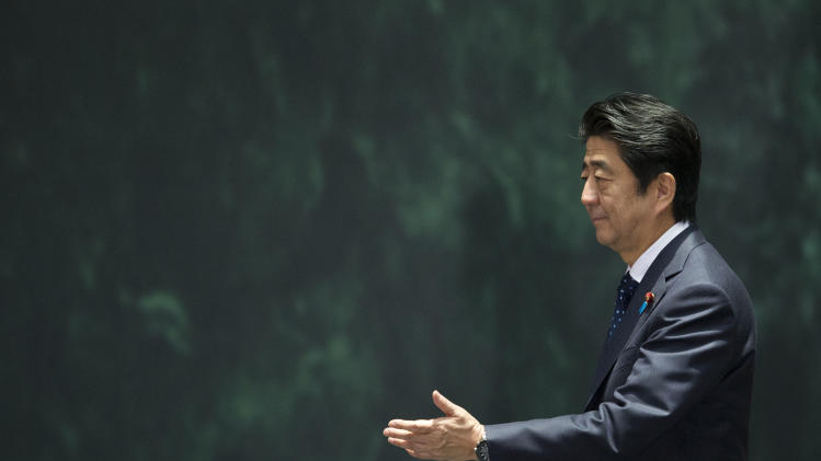 Japanese Prime Minister Shinzo Abe arrives to address Mexican and Japanese press and dignitaries, at the National Palace in Mexico City, Friday, July 25, 2014. Abe was on an official visit to Mexico. (AP Photo/Rebecca Blackwell)
