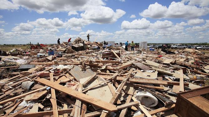 FILE - This May 25, 2011 file photo shows damage following a tornado near Piedmont, Okla. In 2011 the United States saw one of the busiest tornado seasons in generations: Nearly 1,700 tornadoes that killed 553 people. With the planet heating up, many scientists seem fairly certain some weather elements like hurricanes and droughts will worsen. But as the traditional season nears, scientists are still trying to figure out if there be more or fewer tornadoes as global warming increases. (AP Photo/The Oklahoman, David McDaniel, File)