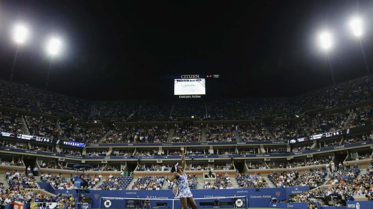 Venus Williams of the U.S. serves to Timea Bacsinszky of Switzerland during their match at the 2014 U.S. Open tennis tournament in New York