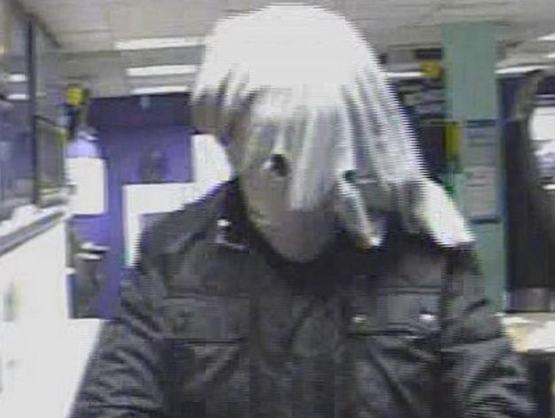 <p>CCTV still of the elephant man masked robber</p>