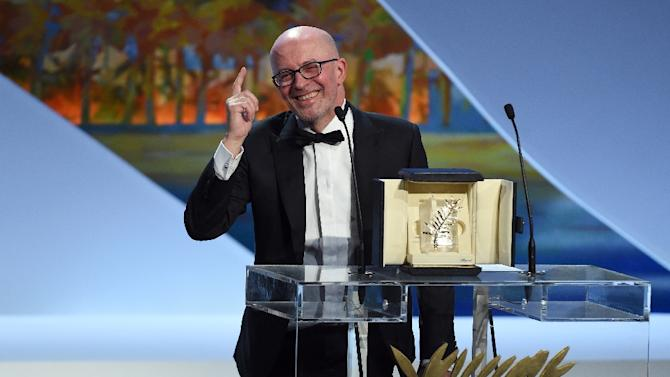 French director Jacques Audiard talks on stage after being awarded with the Palme d'Or during the closing ceremony of the 68th Cannes Film Festival in Cannes, France, on May 24, 2015