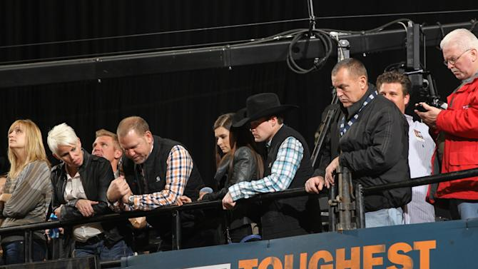 This image provided by the Professional Bull Riders shows Danica Patrick and Ricky Stenhouse Jr.,  center, during the championship round of the Winston-Salem Professional Bull Riders Built Ford Tough series Saturday Jan. 19, 2013. Patrick revealed to The Associated Press Friday Jan. 25, 2013  she and Ricky Stenhouse Jr. are a couple, ending widespread speculation about the nature of their relationship. (AP Photo/Professional Bull Riders, Andy Watson )