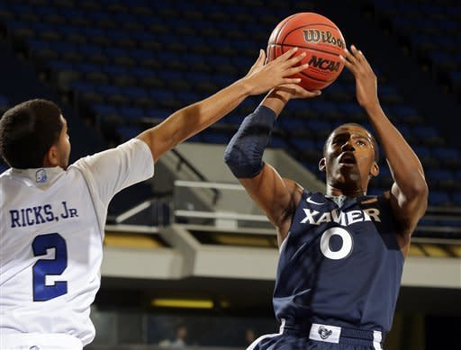Xavier outlasts Drake 74-70