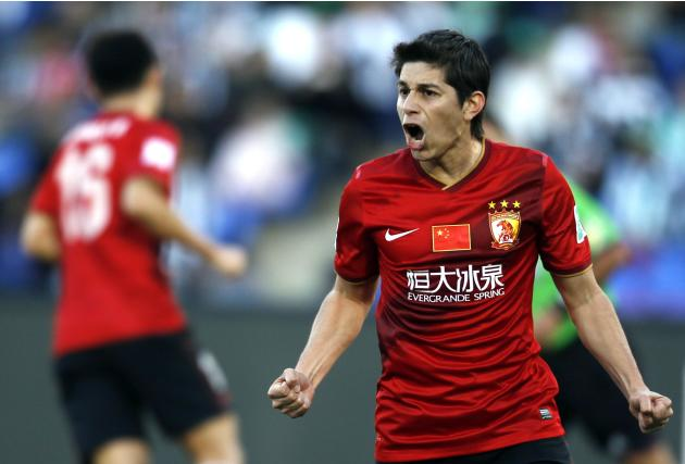 Dario Conca of China's Guangzhou Evergrande celebrates after scoring a goal against Brazil's Atletico Mineiro during their 2013 FIFA Club World Cup third place soccer match in Marrakech stadiu