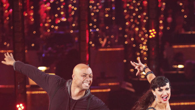 """In this Nov. 14, 2011 image released by ABC, war veteran J.R. Martinez, left, and his partner Karina Smirnoff perform on the celebrity dance competition series """"Dancing with the Stars,"""" in Los Angeles. (AP Photo/ABC, Adam Taylor)"""