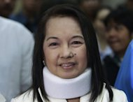 Former Philippine president Gloria Arroyo, seen here in February 2012, has registered to run for another term in Congress, despite facing graft charges and claiming to be suffering a serious illness that needs treatment abroad