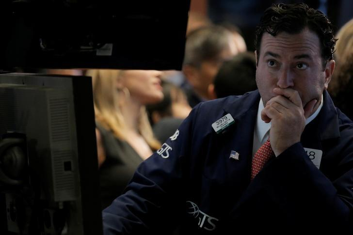 Wall St. falls as healthcare, materials stumble