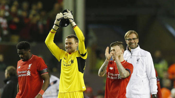 Liverpool manager Juergen Klopp, Alberto Moreno, Simon Mignolet and Kolo Toure celebrates at the end of the match