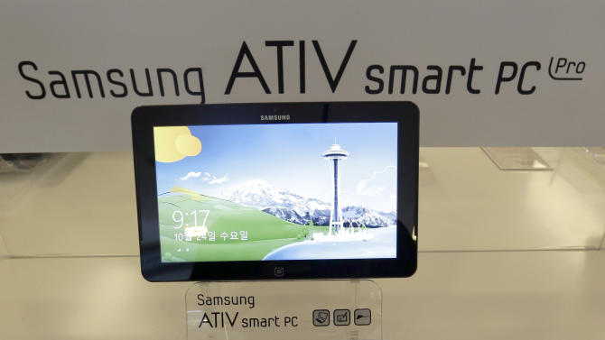 Samsung Electronics Co.'s ATIV smart PC, powered by a new version of Microsoft's Windows operating system, is displayed before a media briefing, in Seoul, South Korea, Wednesday, Oct. 24, 2012. Samsung said Wednesday it expects 10 percent growth in PC sales by volume this year as it bets on new PCs that are hybrids of laptops and tablets to lift sluggish PC demand. (AP Photo/Lee Jin-man)