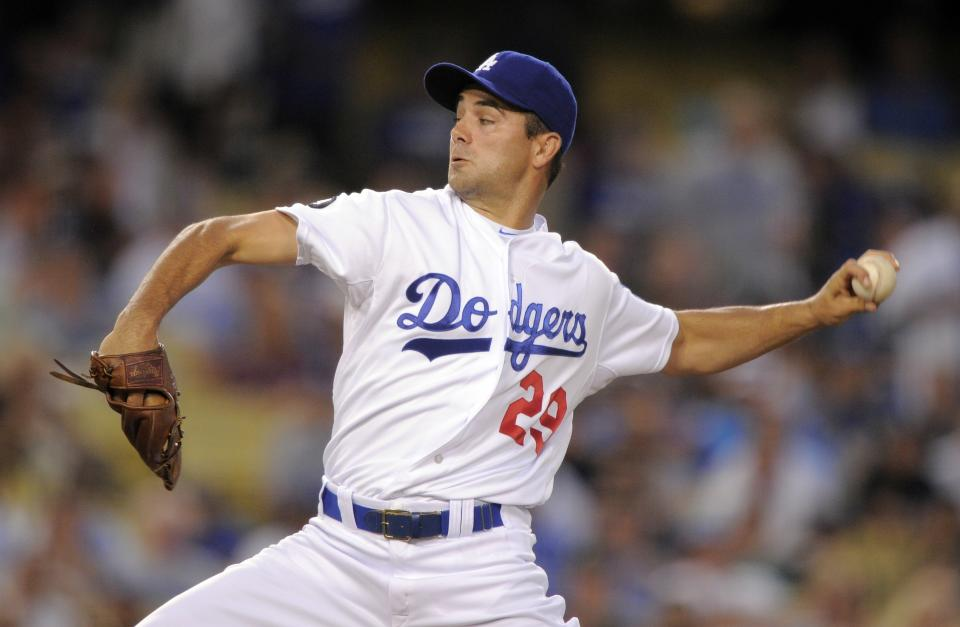 Los Angeles Dodgers starting pitcher Ted Lilly throws to the plate during the first inning of their baseball game against the Los Angeles Dodgers, Friday, Aug. 26, 2011, in Los Angeles. (AP Photo/Mark J. Terrill)