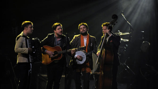 """Musical group Mumford & Sons perform """"I'm on Fire"""" onstage at the MusiCares Person of the Year tribute honoring Bruce Springsteen at the Los Angeles Convention Center on Friday Feb. 8, 2013, in Los Angeles. (Photo by Chris Pizzello/Invision/AP)"""