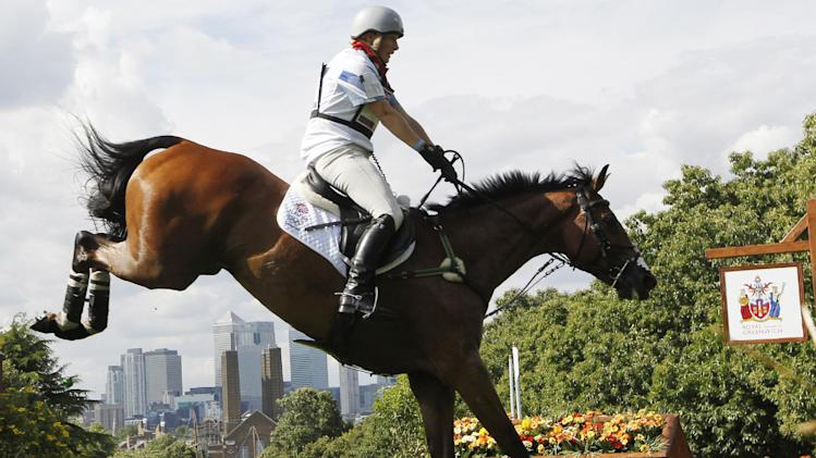 Zara Phillips of Great Britain rides High Kingdom as she competes in the equestrian eventing cross-country stage at the 2012 Summer Olympics, Monday, July 30, 2012, in London. (AP Photo/Ng Han Guan)