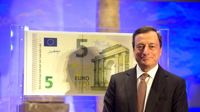 """European Central Bank ECB President Mario Draghi unveils the new 5 euro banknote at the Archaeological Museum in Frankfurt,Germany,  Thursday Jan. 10, 2013 . The exhibition """" (AP Photo/dpa/Boris Roessler)"""