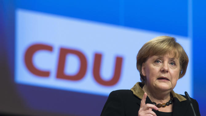 German Chancellor and chairwoman of the Christian Democratic Party, CDU, Angela Merkel delivers her keynote speech at the Party's 2012 convention in Hannover, Tuesday, Dec. 4, 2012. The ruling CDU will elect a new board and re-elect Angela Merkel as the party's chairwoman at the convention. (AP Photo/Markus Schreiber)
