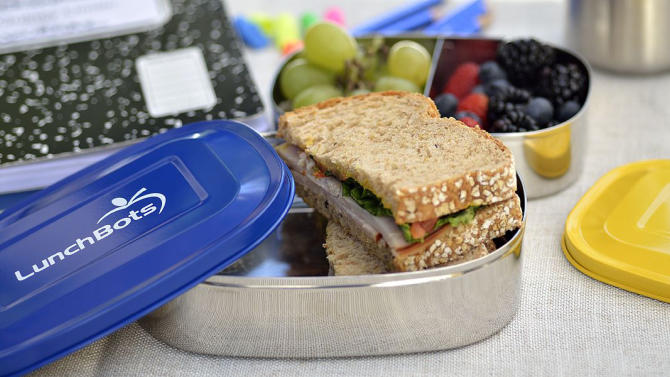 In this photo provided by LunchBots, multi-compartment divided containers make it easy to pack sandwiches and fruit as shown here. (AP Photo/LunchBots)