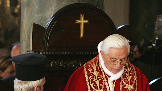 """FILE - This Nov. 30, 2006 file photo shows Pope Benedict XVI, looking on during a solemn ceremony with Ecumenical Orthodox Patriarch Bartholomew I, unseen, in the Patriarchal Church of St. George, in Istanbul, Turkey, At the moment Cardinal Albino Luciani learned his colleagues had elected him pope, he responded, """"May God forgive you for what you've done.'' The remark, by the man who became Pope John Paul I, was seen as an expression of humility, but also a commentary on the mammoth task ahead. There is no job like that of the pope. He is the CEO of a global enterprise, head of state, a moral voice in the world and, in the eyes of Roman Catholics, Christ's representative on earth. The man who emerges as pontiff from the conclave starting Tuesday has a crushing to-do list as he leads the world's 1.2 billion Catholics. (AP Photo/Patrick Hertzog, pool, file)"""