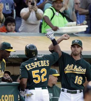Parker leads A's past Yankees 2-1