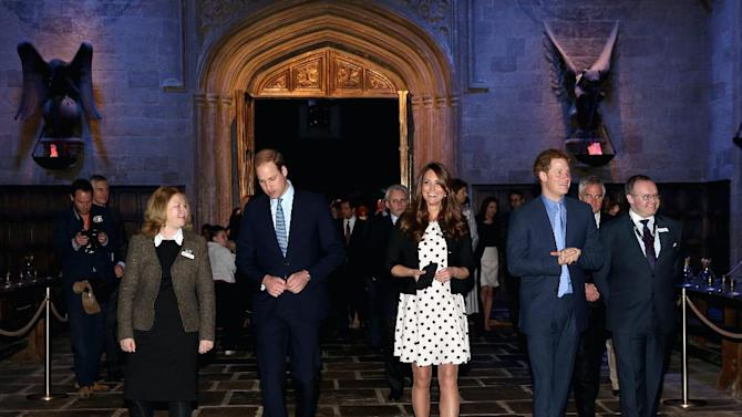 "Britain's Kate the Duchess of Cambridge, center, with her husband Prince William, second left, and his brother Prince Harry, second right, walk through the set used to depict Hogwart's 'Great Hall' in the Harry Potter Films during the inauguration of ""Warner Bros. Studios Leavesden"" near Watford, approximately 18 miles north west of central London, Friday, April 26, 2013. As well as attending the inauguration Friday at the former World War II airfield site, the royals will undertake a tour of Warner Bros. ""Studio Tour London - The Making of Harry Potter"", where they will view props, costumes and models from the Harry Potter film series. (AP Photo/Chris Jackson, Pool)"