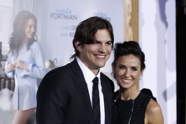 "FILE - In this Jan. 11, 2011 file photo, cast member Ashton Kutcher, left, and Demi Moore arrive at the premiere ""No Strings Attached"" in Los Angeles. Moore is seeking spousal support from Kutcher, according to divorce paperwork filed Thursday March 7, 2013, in Los Angeles. The couple split in 2011 after more than six years of marriage. (AP Photo/Matt Sayles, File)"