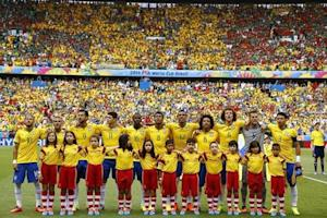 Team Brazil pose before the 2014 World Cup Group A soccer match between Brazil and Mexico at the Castelao arena