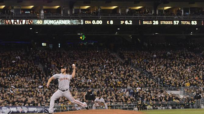 San Francisco Giants starting pitcher Madison Bumgarner throws against the Pittsburgh Pirates in the seventh inning of the NL wild-card playoff baseball game Wednesday, Oct. 1, 2014, in Pittsburgh. (AP Photo/Don Wright)