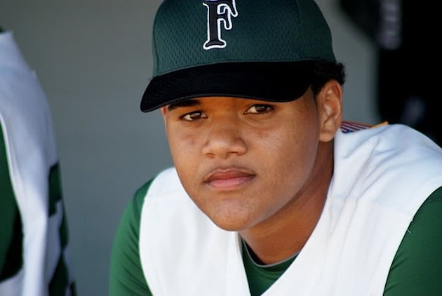 Flanagan pitcher Jose Mesa Jr. in his team's dugout — Facebook