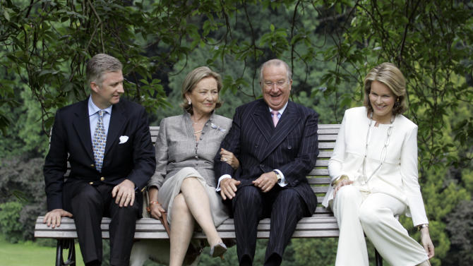 File - In this June 17, 2008 file photo, from left to right, Belgium's Crown Prince Philippe, Queen Paola, King Albert II and Belgium's Princess Mathilde sit during an official photo session at the Royal Palace in Laeken, Belgium. Albert II's kingdom is increasingly threatened by royal-bashing separatists seeking the breakup of Belgium. Now, a book dipping deep into the privacy of kings and princes is adding insult to injury. With its back against the wall, the royal palace sought to strike back in the week of Oct. 29, 2012, seeking action against the journalist who published the book ''Royal Questions'' which is sometimes as rich on dangerous liaisons as it is on the use of anonymous sources. (AP Photo/Virginia Mayo, File)