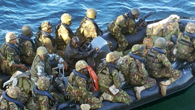 This undated photo provided by Kenya's Ministry for Defence on Friday, Sept. 28, 2012, is said by them to show Kenya Defence Forces troops at an undisclosed location in Kenya, engaged in recent preparations for an assault on the Somali port city of Kismayo. Kenyan troops invaded al-Shabab's last stronghold in Somalia on Friday, coming ashore in a predawn beach landing at Kismayo that appeared likely to deprive the Islamist insurgents of their last big money-making enterprise. (AP Photo/Kenya Ministry for Defense)