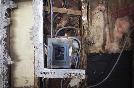 An electrical panel is pictured inside what is left of Nicole Chati's house after Superstorm Sandy in the Staten Island borough of New York