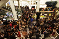 <p>               People rush into a department store as it opens for Boxing Day sales in central London, Monday, Dec. 26, 2011. Despite disruptions caused by London's subway drivers striking over a pay dispute, large crowds of shoppers started flooding department stores in London as soon as doors opened early Monday. (AP Photo/Lefteris Pitarakis)