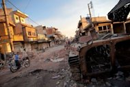 "<p>A destroyed Syrian forces tank remains in a damaged street in Atareb in northern Aleppo province on July 2. China has joined Russia in boycotting a ""Friends of Syria"" meeting aimed at coordinating efforts to stop violence in the country, where three senior regime officers are among the latest to be killed.</p>"