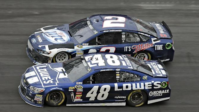 Jimmie Johnson (48) competes with Brad Keselowski (2) during late stages of the Daytona 500 NASCAR Sprint Cup Series auto race, Sunday, Feb. 24, 2013, at Daytona International Speedway in Daytona Beach, Fla. Johnson won the race. (AP Photo/Chris O'Meara)