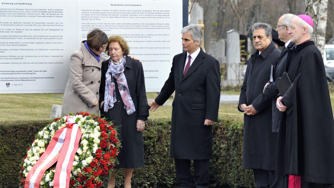 """Interior Minister Johanna Mikl-Leitner, Resistance fighter Katharina Sasso, Austrian Chancellor Werner Faymann, President of Islamic Community Fuat Sanac, Protestant Bishop Michael Buenker and Catholic Bishop Franz Scharl, from left, attend the unveiling of a plaque honoring the thousands of Austrians killed by the Nazis for opposing them, before and after the so-called """"Anschluss"""" at the Central Cemetary in Vienna, Austria, Monday, March 11, 2013. Austria's chancellor has urged fellow Austrians to strive to prevent a return of the political climate that allowed Nazi atrocities, in comments marking Germany's annexation of Austria 75 years ago. (AP Photo/Hans Punz)"""