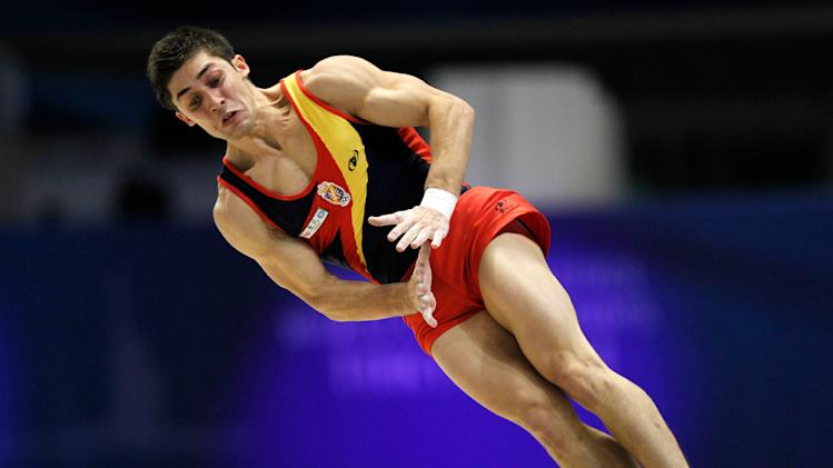 Spain's Javier Gomez Fuertes performs the floor exercise during the men's qualifying of the Artistic Gymnastics World Championships in Tokyo, Japan, Monday, Oct. 10, 2011. (AP Photo/Koji Sasahara)